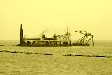 mining ships: Suction sand shipping in the sea, closeup of photo