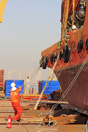 bound: TIANJIN PORT - MARCH 23: workers were bound and fixed the ship, on March 23, 2015, tianjin port, tianjin, China.