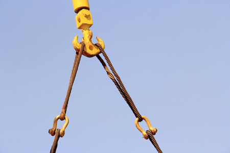 solid wire: crane sling in the sky, closeup of photo