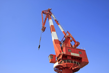 leverage: Crane under the blue sky background, closeup of photo