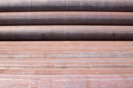 semi finished goods: Piles of steel pipe, closeup of photo