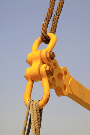 fasteners: yellow metal fasteners and wire rope, closeup of photo