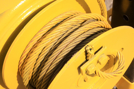 strong toughness: yellow steel wire rope, closeup of photo