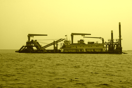 mining ship: Suction sand shipping in the sea, closeup of photo