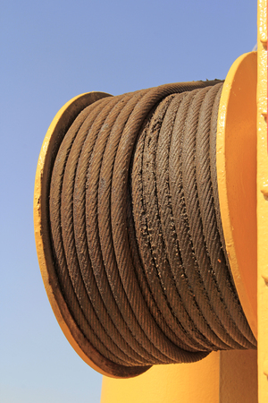toughness: steel wire rope and yellow steel plate, closeup of photo Stock Photo