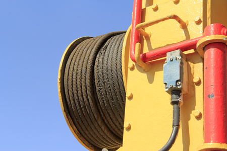 strong toughness: steel wire rope and yellow steel plate, closeup of photo Editorial