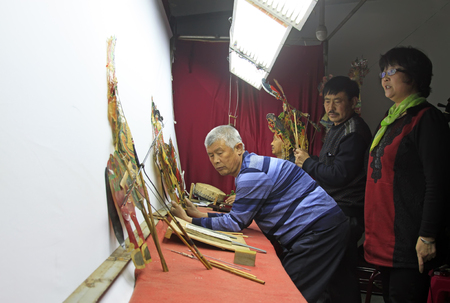 folk heritage: LUANNAN COUNTY- March 30: Chinese shadow play performances scene, on March 30, 2015, Luannan, Hebei Province, china.