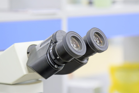 an eyepiece: medical microscope, closeup of photo