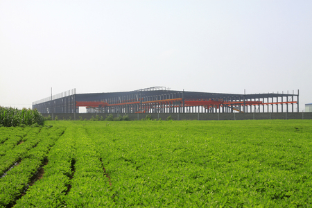 agricultural engineering: Workshop framework and farmland, closeup of photo