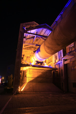 idle: idle cement plant rotary kiln machinery at night, closeup of photo