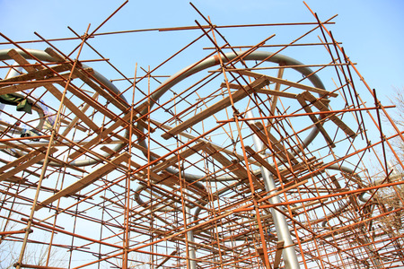 steel pipe: steel pipe scaffold in the construction site, closeup of photo Editorial