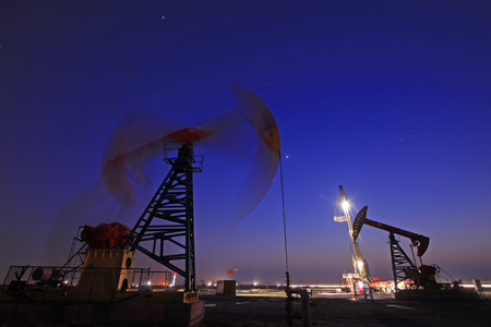 Crank balanced beam pumping unit in Jidong oilfield sunset scenery, Hebei Province, China 写真素材