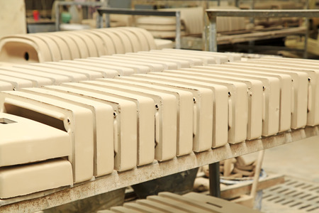semifinished: Ceramic semi-finished products on the production line in a factory, closeup of photo Stock Photo