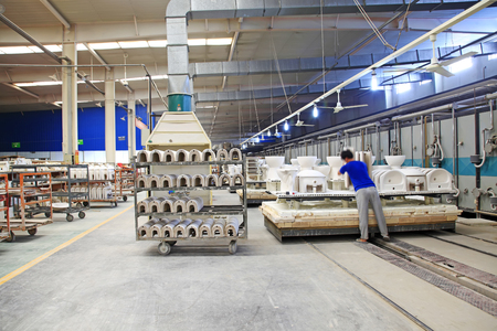 standardization: Luannan - May 31: workers in the sintering workshop production line, on May 31, 2015, luannan county, hebei province, China