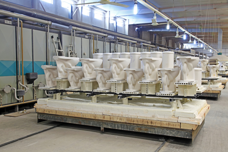 mechanization: ceramic sintering workshop production line in a factory, closeup of photo Stock Photo
