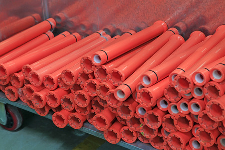 plastic material: red plastic material spindles rollers, closeup of photo