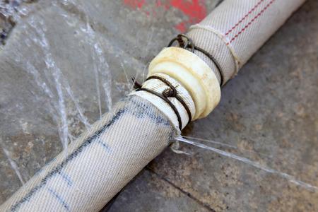 nylon: Nylon pipe leaks, closeup of photo Stock Photo