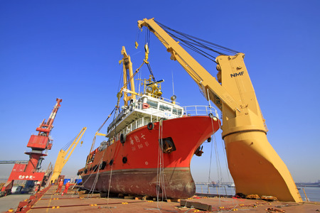 jib: TIANJIN PORT - MARCH 23: seal 7 Exploration ship was hoisted in a large cargo ship, on March 23, 2015, tianjin port, tianjin, China.