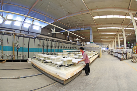mechanization: Luannan - May 31: Sintering workshop production line view in ceramic company, on May 31, 2015, luannan county, hebei province, China Editorial
