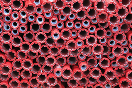 spindles: red plastic material spindles rollers, closeup of photo