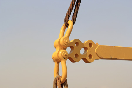 wire rope: yellow metal fasteners and wire rope, closeup of photo