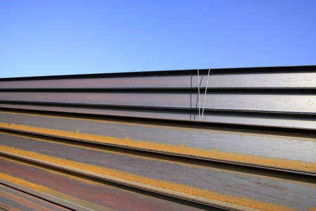 blue steel: rolled steel pile up together, closeup of photo Stock Photo