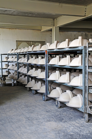 semifinished: Ceramic semi-finished products on the production line in a factory, closeup of photo Editorial