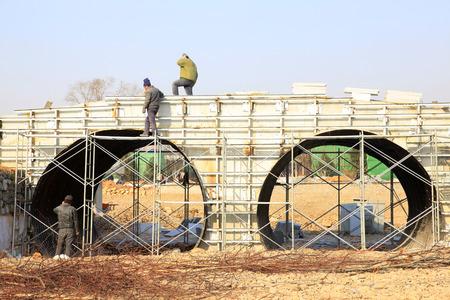 orifice: Double orifice arch bridge construction site, closeup of photo