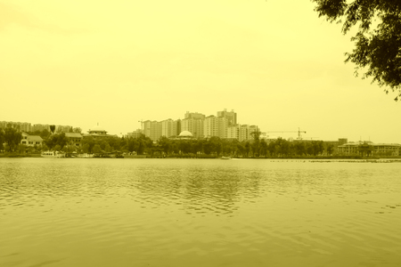high rise buildings: Wide water surface and high rise buildings in a park