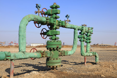 facilitated: Oil pipeline on the ground, closeup of photo