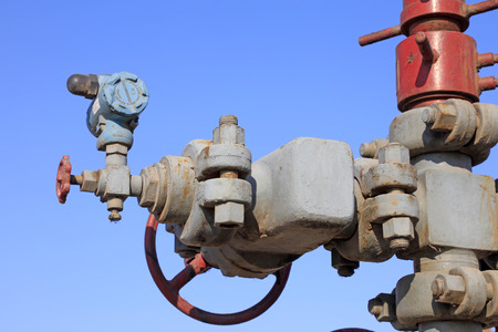 damage control: Oil pipeline and equipment under the blue sky, closeup of photo Stock Photo