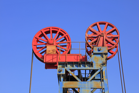 oilfield: Petroleum machinery parts under blue sky in oilfield Stock Photo