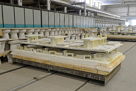 mechanization: ceramic sintering workshop production line in a factory, closeup of photo Editorial