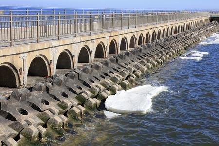 ice dam: bridge tunnel and breakwater, closeup of photo Stock Photo