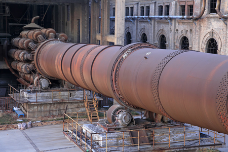 idle: idle cement plant rotary kiln machinery, closeup of photo Editorial