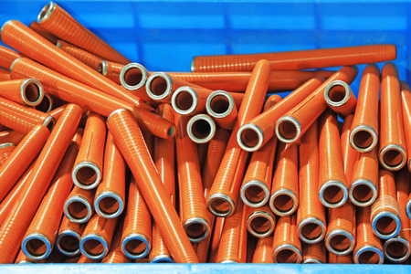 spindles: plastic material spindles rollers, closeup of photo Editorial