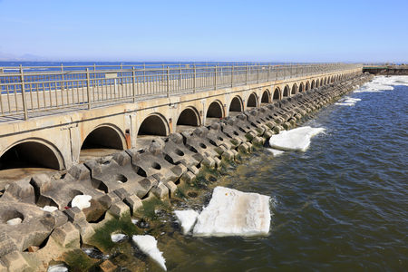 ice dam: bridge tunnel and breakwater, closeup of photo Stock Photo