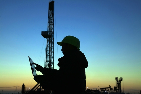 Oil drilling frame and exploration technician in a oilfield
