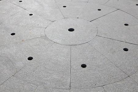 flagstone: Holes and marks on the flagstone, closeup of photo Stock Photo