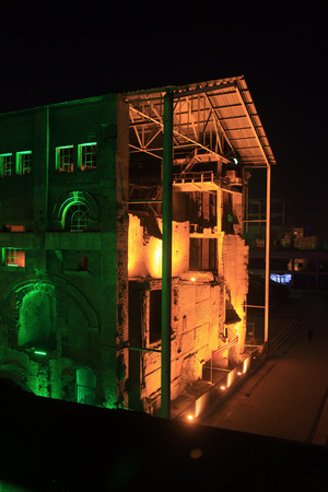 antique factory: idle cement plant at night, closeup of photo Editorial