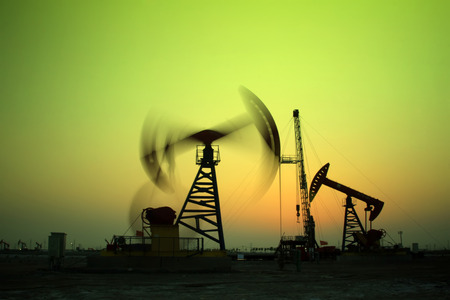 machinery space: Crank balanced beam pumping unit in Jidong oilfield sunset scenery, Hebei Province, China Editorial