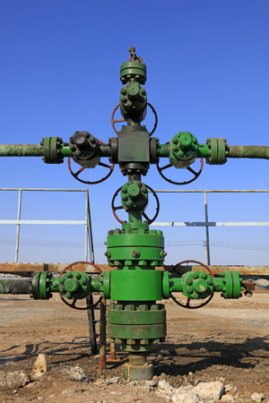 Oil pipeline on the ground, closeup of photo