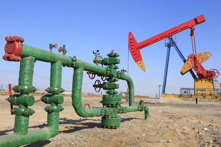 facilitated: Oil pipeline and pumping unit, closeup of photo Editorial