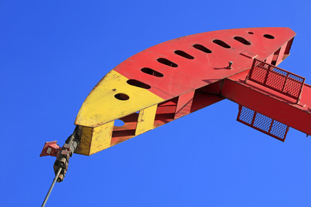 pumping unit: Petroleum machinery pumping unit parts in the blue sky Stock Photo