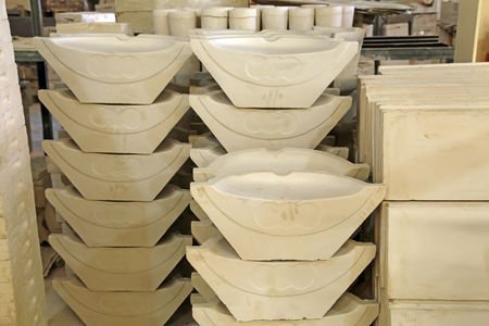mechanization: Ceramic semi-finished products on the production line in a factory, closeup of photo Stock Photo