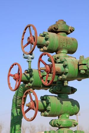 damage control: Oil pipeline control handwheel under the blue sky, closeup of photo