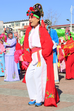Luannan County- February 17: Chinese traditional style yangko folk dance performance in the street, on February 17, 2016, luannan County, hebei Province, China Editorial