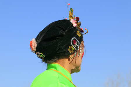 witty: Chinese traditional style yangko folk dance performance headwear in the street, luannan County, hebei Province, China Stock Photo