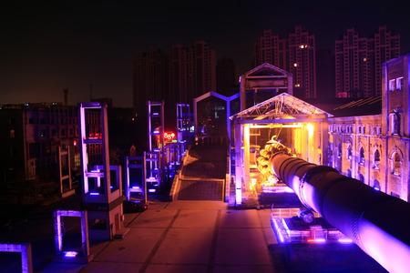 kiln: idle cement plant rotary kiln machinery at night