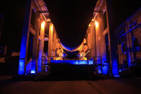 idle: idle cement plant rotary kiln machinery at night